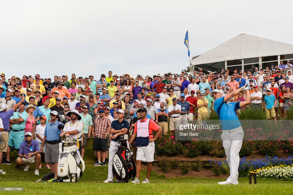 Fans watch as Martin Kaymer of Germany tees off on the 18th hole during the third round of THE PLAYERS Championship on THE PLAYERS Stadium Course at TPC Sawgrass on May 10, 2014 in Ponte Vedra Beach, Florida.