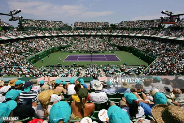 Fans watch as Novak Djokovic of Serbia plays against Andy Murray of Great Britain during the men's final of the Sony Ericsson Open at the Crandon...