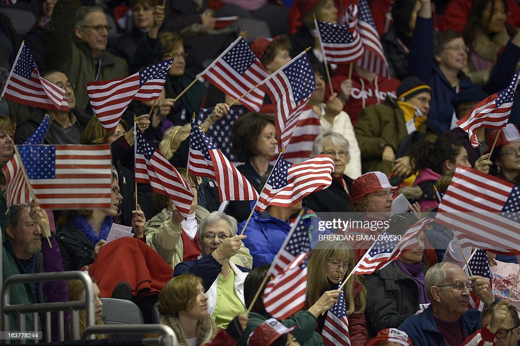 Fans watch as Ross Miner competes for the United States during the Men's Free Skate event at the 2013 World Figure Skating Championships March 15, 2013 in London, Ontario, Canada. AFP PHOTO/Brendan SMIALOWSKI