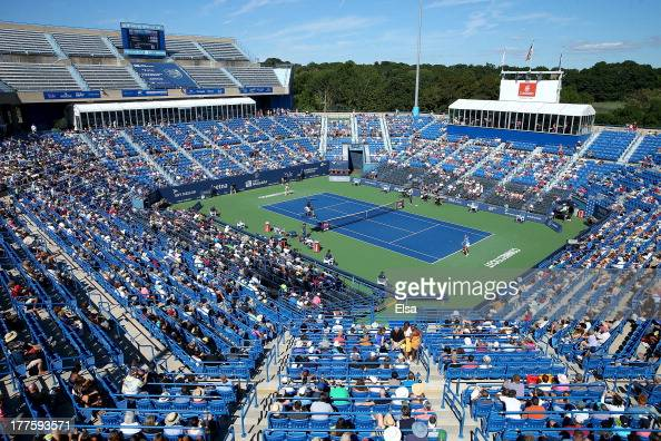 Fans watch as Simona Halep of Romania takes on Petra Kvitova of the Czech Republic during the Women's Final on Day Seven of the New Haven Open at...
