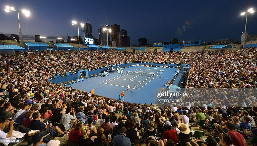 Fans watch as Spain's Fernando Verdasco competes during his men's singles match against Belgium's Xavier Malisse at Margaret Court arena on the third day of the Australian Open tennis tournament in Melbourne on January 16, 2013. AFP PHOTO / PETER PARKS IMAGE STRICTLY RESTRICTED TO EDITORIAL USE - STRICTLY NO COMMERCIAL USE