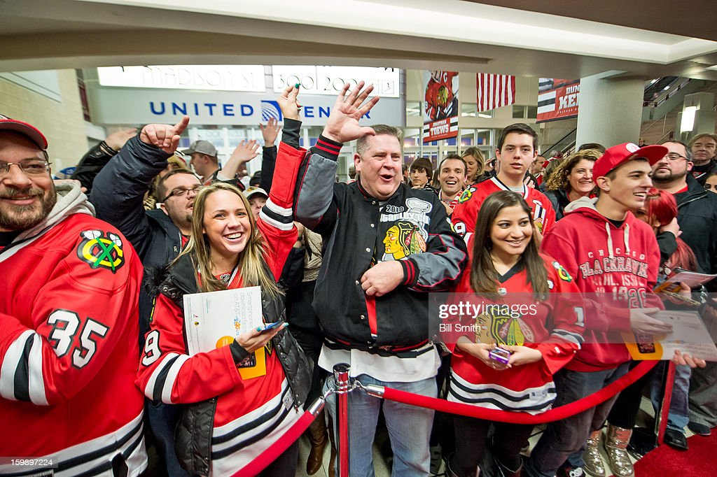 Fans watch as the Chicago Blackhawks arrive before the NHL game against the St. Louis Blues on January 22, 2013 at the United Center in Chicago, Illinois.