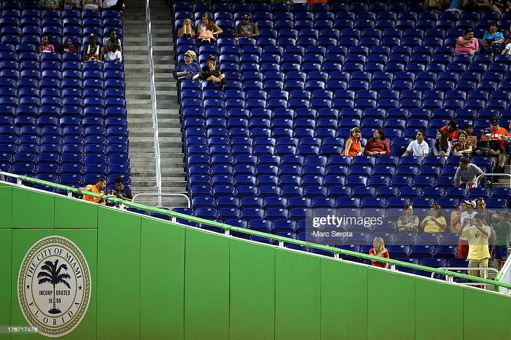 Fans watch as the Miami Marlins play against the San Francisco Giants at Marlins Park on August 17, 2013 in Miami, Florida. The Giants defeated the Marlins 6-4.