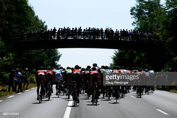 Fans watch as the peloton leaves Pau at the start of stage eleven of the 2015 Tour de France a 188 km stage between Pau and Cauterets on July 15 2015...