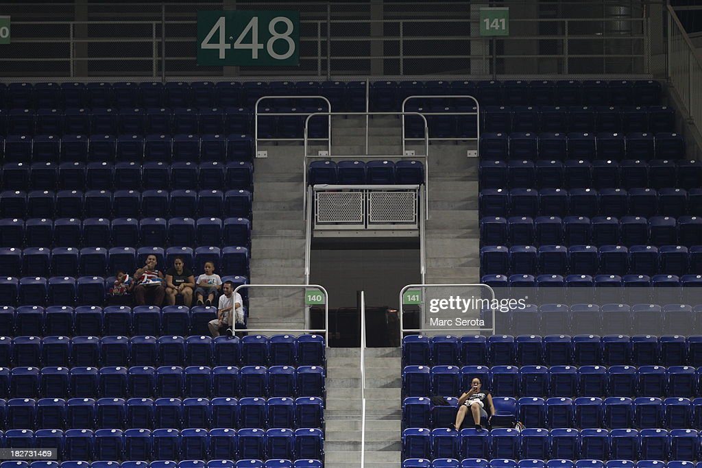 Fans watch as the Philadelphia Phillies play against the Miami Marlins at Marlins Park on September 24, 2013 in Miami, Florida. The Phillies defeated the Marlins 2-1 to give Miami 100 losses for the season.