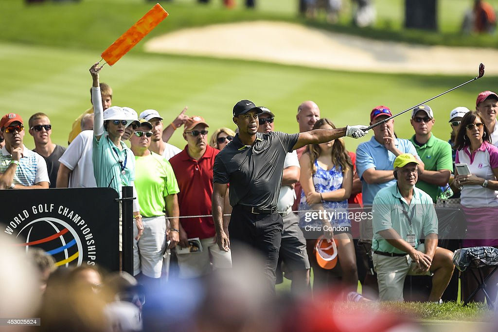 Fans watch as <a gi-track='captionPersonalityLinkClicked' href=/galleries/search?phrase=Tiger+Woods&family=editorial&specificpeople=157537 ng-click='$event.stopPropagation()'>Tiger Woods</a> reacts to his tee shot on the 11th hole during the second round of the World Golf Championships-Bridgestone Invitational at Firestone Country Club on August 1, 2014 in Akron, Ohio.