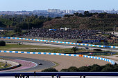 Fans watch as Valtteri Bottas of Finland and Williams and Nico Rosberg of Germany and Mercedes GP drive on track during day one of Formula One Winter...
