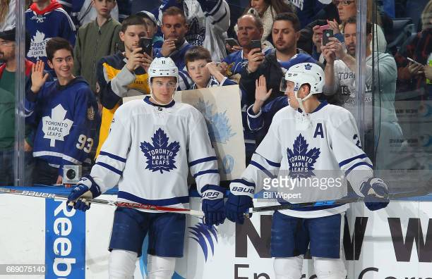 Fans watch as Zach Hyman and Matt Hunwick of the Toronto Maple Leafs warm up before an NHL game against the Buffalo Sabres at the KeyBank Center on...