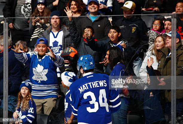 Fans watch Auston Matthews of the Toronto Maple Leafs during warmup before playing the Colorado Avalanche at the Air Canada Centre on December 11...