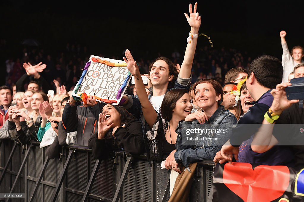 Fans watch Coldplay perform on stage during the Sentebale Concert at Kensington Palace on June 28, 2016 in London, England. Sentebale was founded by Prince Harry and Prince Seeiso of Lesotho over ten years ago. It helps the vulnerable and HIV positive children of Lesotho and Botswana.