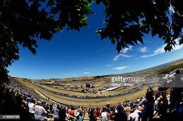 Fans watch during the NASCAR Sprint Cup Series Toyota/Save Mart 350 at Sonoma Raceway on June 28 2015 in Sonoma California