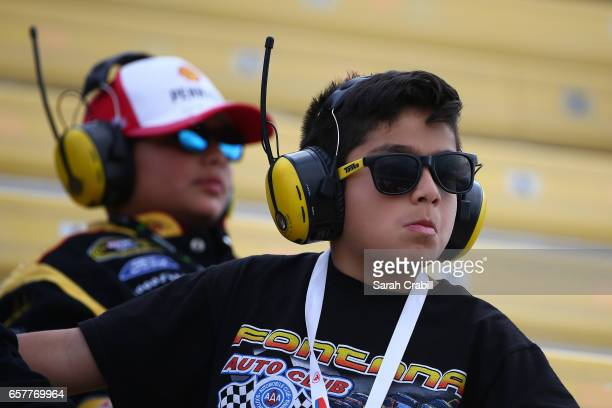 Fans watch during the NASCAR XFINITY Series Service King 300 at Auto Club Speedway on March 25 2017 in Fontana California