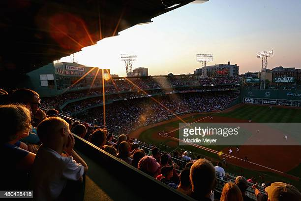 Fans watch Eduardo Rodriguez of the Boston Red Sox pitch against the New York Yankees during the second inning at Fenway Park on July 11 2015 in...