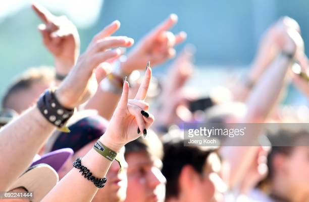 Fans watch 'Five Finger Death Punch' during Rock Im Park 2017 at Zeppelinfeld on June 4 2017 in Nuremberg Germany