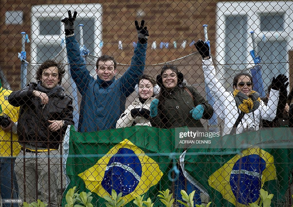 Fans watch from a garden as the Brazilian team train at The Hive, Barnet FC's training ground in Edgware, London on February 5, 2013. Brazil are set to play England in an international friendly at London's Wembley Stadium on February 6, 2013.