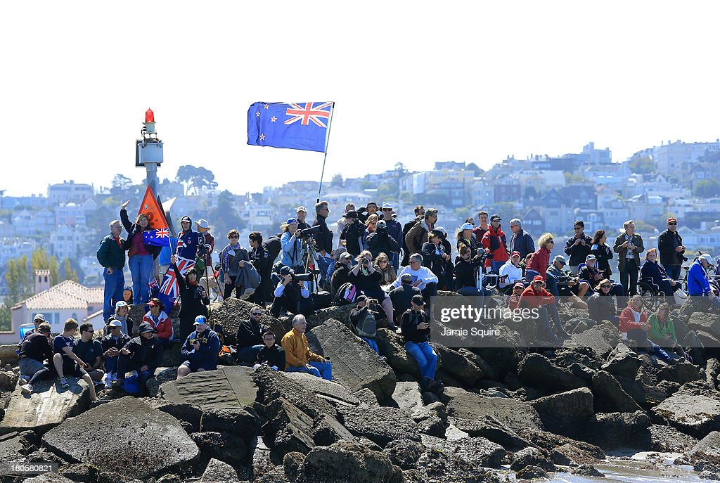 Fans watch from a jetty during race 8 of the America's Cup Finals on September 14, 2013 in San Francisco, California.