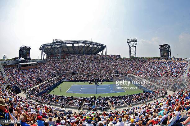 Fans watch from Louis Armstrong Stadium as Mardy Fish of the United States plays in his Men's Singles Second Round match against Feliciano Lopez of...