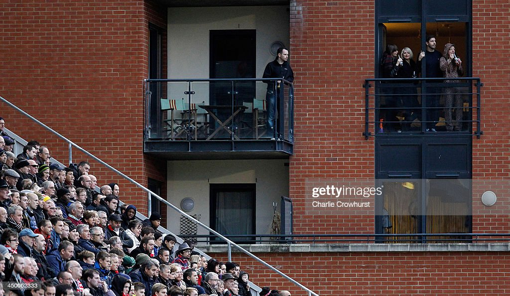 Fans watch from the balconies of apartments overlooking the ground during the Sky Bet League One match between Leyton Orient and Preston North End at The Matchroom Stadium on November 16, 2013 in London, England.