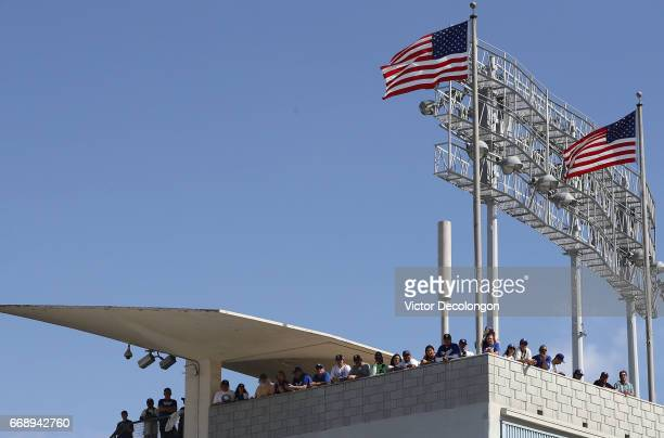 Fans watch from the left field upper deck seats the Los Angeles Dodgers Jackie Robinson Statue unveiling at Dodger Stadium on April 15 2017 in Los...