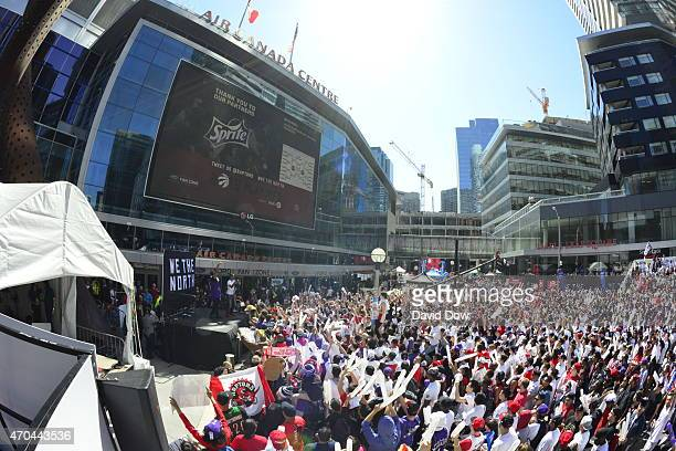 Fans watch Game One of the Eastern Conference Playoffs Washington Wizards against the Toronto Raptors outside of the Air Canada Centre on April 18...