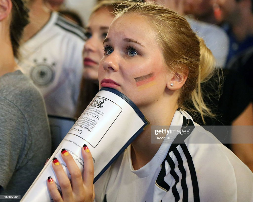 Fans watch Germany play Argentina during the 2014 FIFA World Cup final at the German beer garden Reichenbach Hall on July 13, 2014 in New York City.