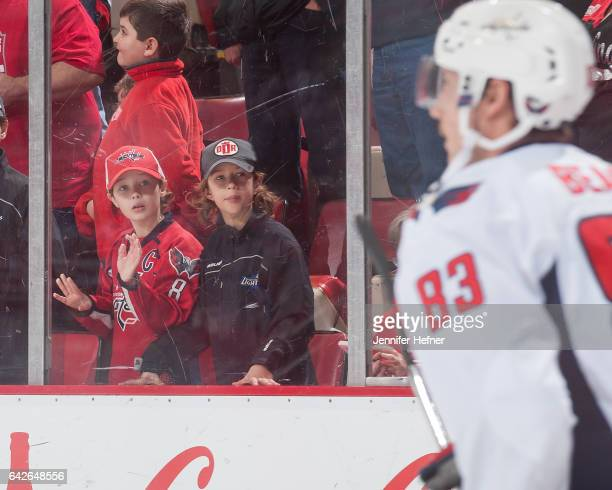 Fans watch Jay Beagle of the Washington Capitals skate in warmups prior to an NHL game against the Detroit Red Wings at Joe Louis Arena on February...