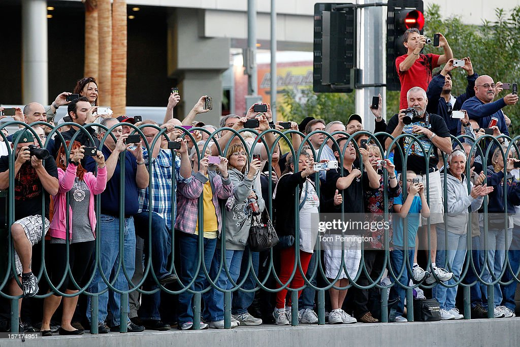 Fans watch NASCAR drivers participate in the NASCAR Victory Lap on the Las Vegas Strip on November 29, 2012 in Las Vegas, Nevada.