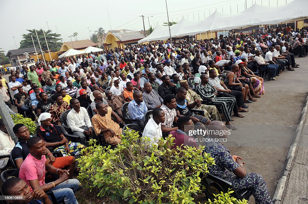 Fans watch on a giant screen the football match opposing Nigeria to Ivory Coast at the 2013 African Cup of Nations on February 3, 2013 at a public viewing centre in Lagos. Supposed underdogs Nigeria downed favourites Ivory Coast 2-1 in an absorbing quarter-final to set up a last-four meeting with Mali.