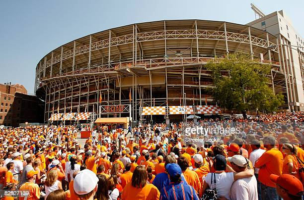 Fans watch on as the Tennessee Volunteers make their way through the crowd during the Vol Walk before the start of their game against the Florida...