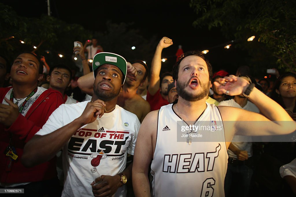 Fans watch on television as the Miami Heat is in the final seconds of the NBA title game against the San Antonio Spurs June 20, 2013 in Miami, Florida. The Heat won back to back championships.