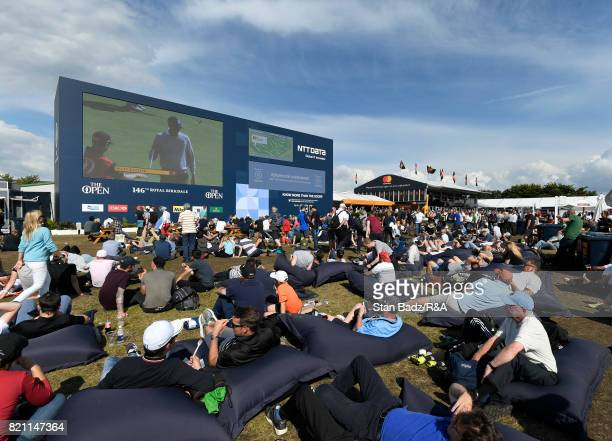 Fans watch play at the spectator village during the third round of the 146th Open Championship at Royal Birkdale on July 22 2017 in Southport England