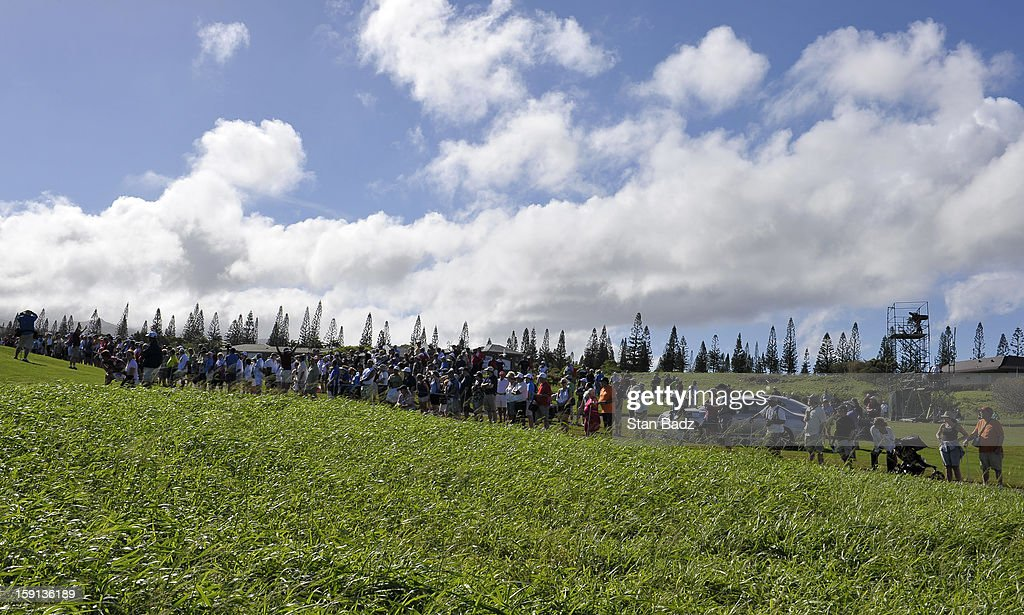 Fans watch play from the 11th hole during the final round of the Hyundai Tournament of Champions at Plantation Course at Kapalua on January 8, 2013 in Kapalua, Maui, Hawaii.