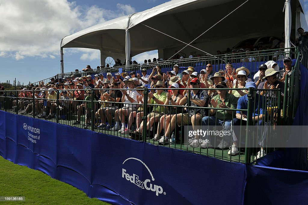 Fans watch play from the 18th gallery during the final round of the Hyundai Tournament of Champions at Plantation Course at Kapalua on January 8, 2013 in Kapalua, Maui, Hawaii.
