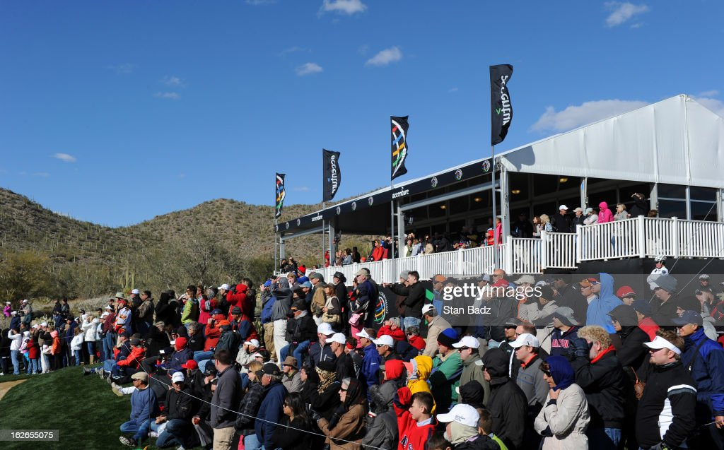 Fans watch play on the 13th hole during the final round of the World Golf Championships-Accenture Match Play Championship at The Golf Club at Dove Mountain on February 24, 2013 in Marana, Arizona.