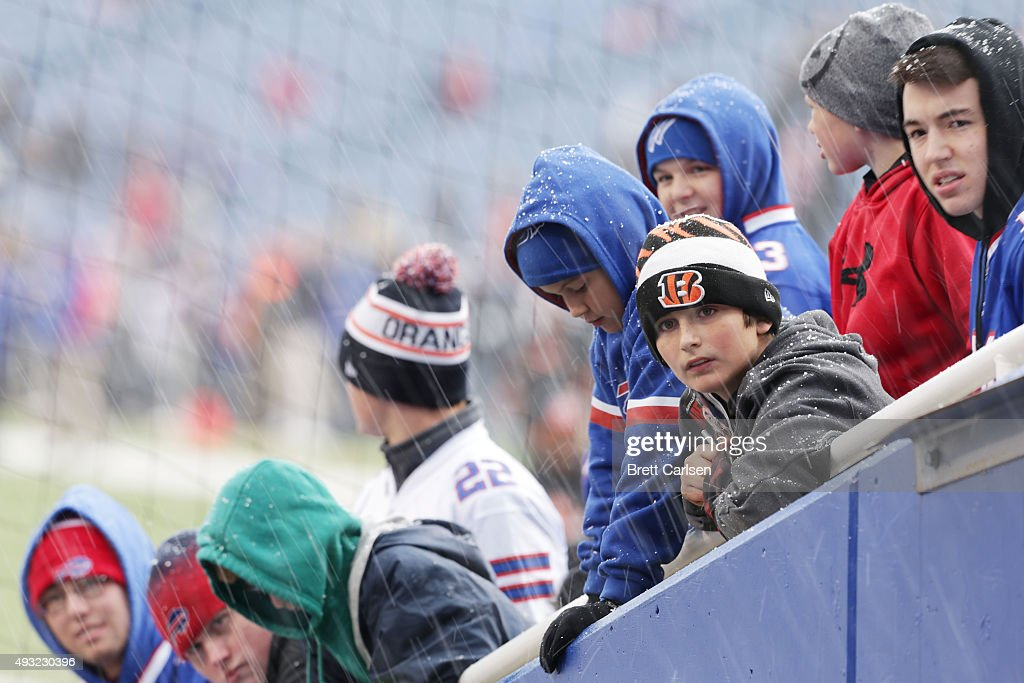 Fans watch players come out of the tunnel as light snow falls before the game between the Buffalo Bills and the Cincinnati Bengals during the first...