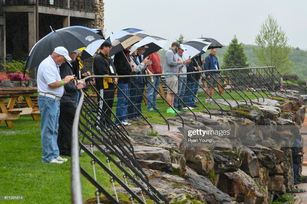 Fans watch players practice on the range during the first round, which was suspended due to weather, of the PGA TOUR Champions Bass Pro Shops Legends of Golf at Big Cedar Lodge at Top of the Rock on April 21, 2017 in Ridgedale, Missouri.