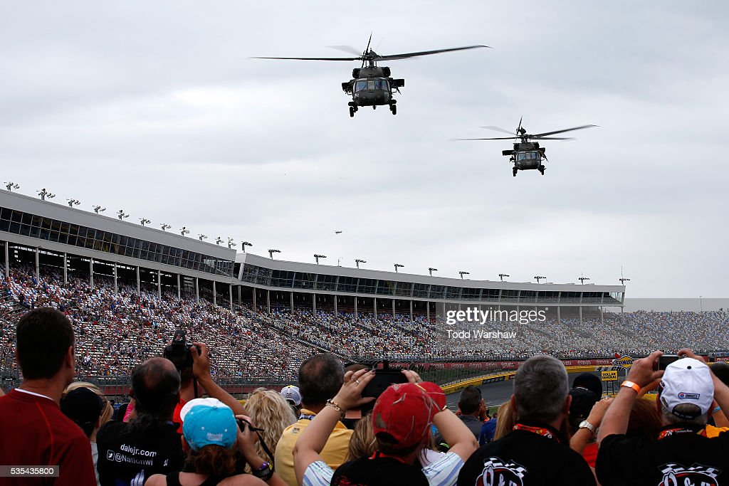 Fans watch pre-race activities prior to the NASCAR Sprint Cup Series Coca-Cola 600 at Charlotte Motor Speedway on May 29, 2016 in Charlotte, North Carolina.