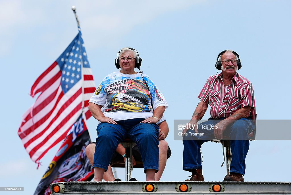 Fans watch race action during the NASCAR Sprint Cup Series Party in the Poconos 400 at Pocono Raceway on June 9, 2013 in Long Pond, Pennsylvania.