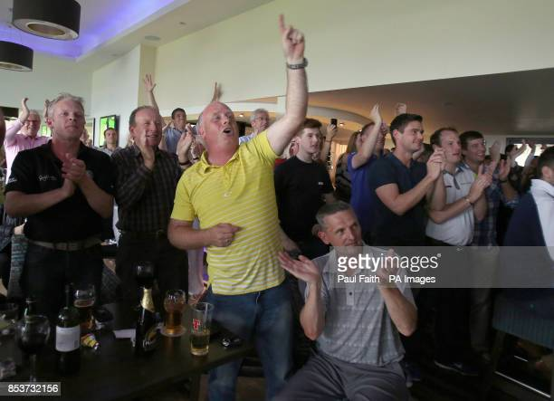 Fans watch Rory McIlroy win The Open on tv screens at Holywood Golf Course County Down