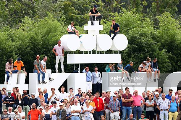 Fans watch the action as Joost Luiten of the Netherlands approaches the 18th green during the final round on day four of the KLM Open at The Dutch on...