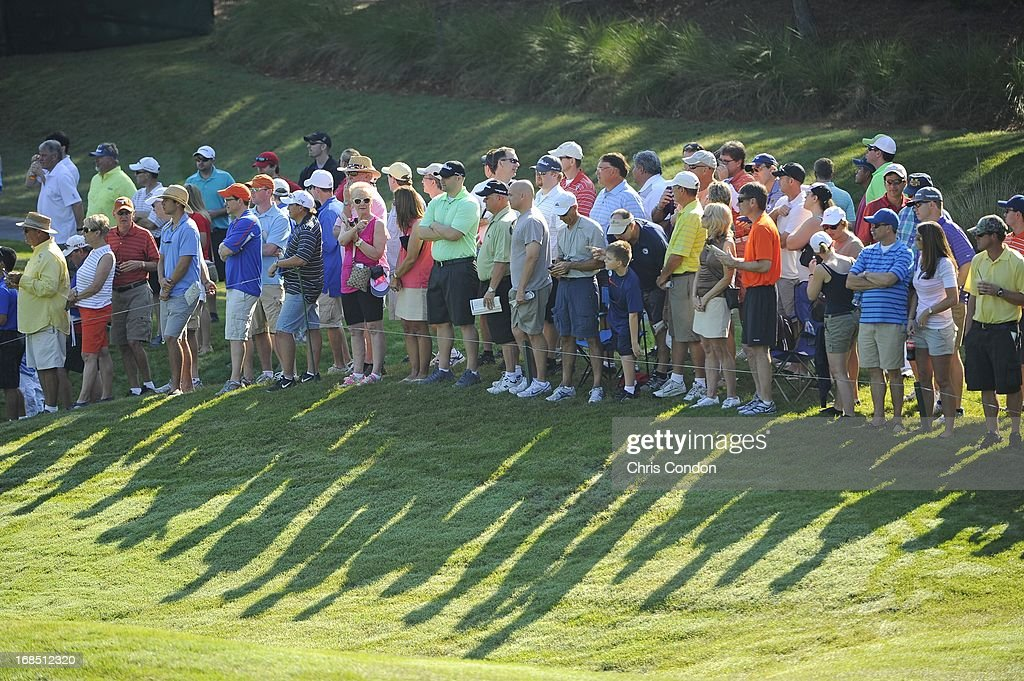 Fans watch the action at the 11th hole during the second round of THE PLAYERS Championship on THE PLAYERS Stadium Course at TPC Sawgrass on May 10, 2013 in Ponte Vedra Beach, Florida.