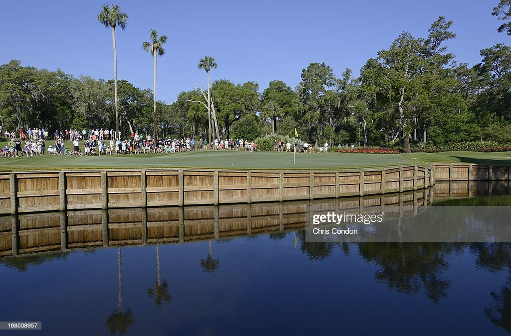 Fans watch the action at the 13th hole during the second round of THE PLAYERS Championship on THE PLAYERS Stadium Course at TPC Sawgrass on May 10, 2013 in Ponte Vedra Beach, Florida.