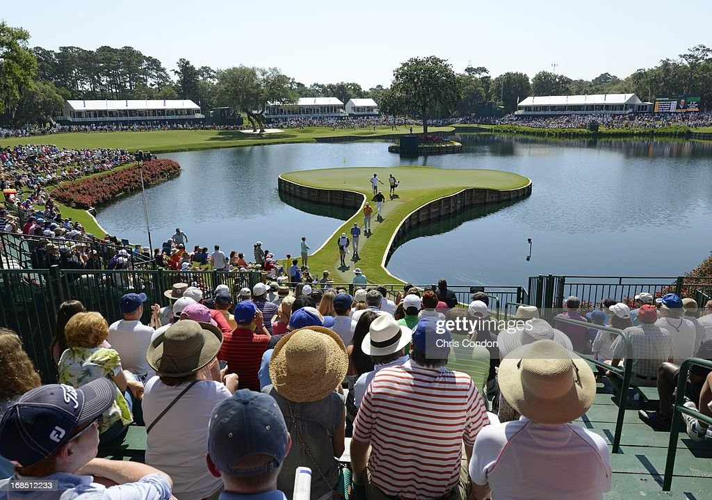 Fans watch the action at the 17th hole during the second round of THE PLAYERS Championship on THE PLAYERS Stadium Course at TPC Sawgrass on May 10, 2013 in Ponte Vedra Beach, Florida.