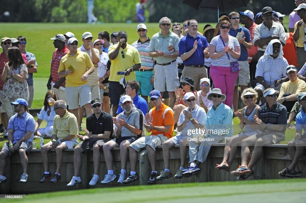 Fans watch the action at the 4th hole during the second round of THE PLAYERS Championship on THE PLAYERS Stadium Course at TPC Sawgrass on May 10, 2013 in Ponte Vedra Beach, Florida.