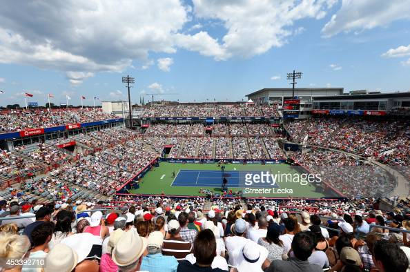Fans watch the action between Serena Williams of the USA and Venus Williams of the USA during the women's semifinals match in the Rogers Cup at...