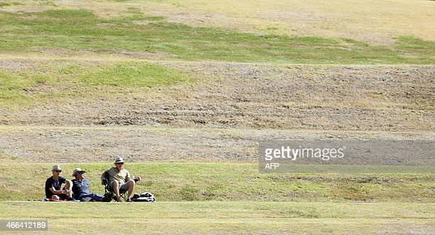 Fans watch the action during day one of the two day international cricket warm up match between the New Zealand XI and India at Cobham Oval in...
