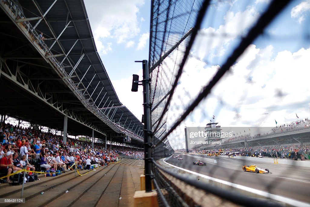 Fans watch the action during the 100th Running of the Indianapolis 500 Mile Race at Indianapolis Motorspeedway on May 29, 2016 in Indianapolis, Indiana.