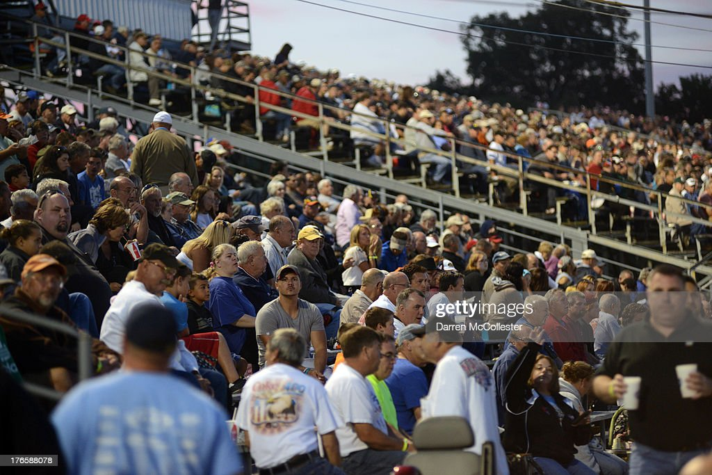 Fans watch the action during the Budweiser King of Beers 150 at Thompson Motor Speedway August 15, 2013 in Thompson, Connecticut.