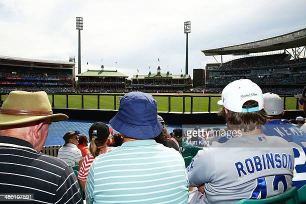 Fans watch the action during the MLB match between the Los Angeles Dodgers and the Arizona Diamondbacks at Sydney Cricket Ground on March 23 2014 in...