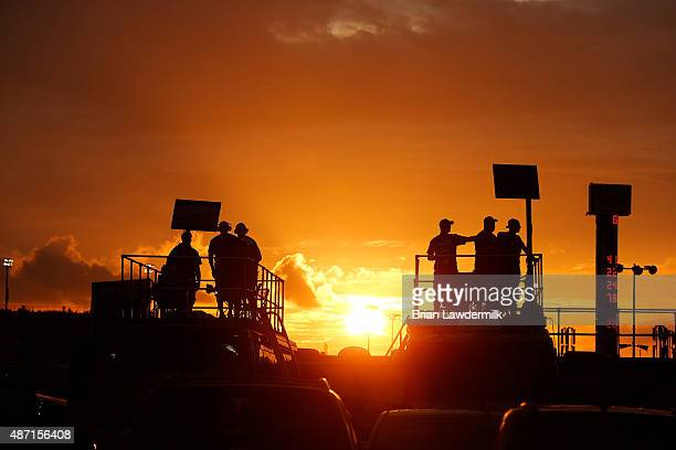 Fans watch the action from the infield during the NASCAR Sprint Cup Series Bojangles' Southern 500 at Darlington Raceway on September 6 2015 in...